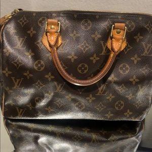 Louis Vuitton Speedy 30 handbag.